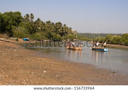ARAMBOL BEACH, INDIA-Jan. 23 - The Indian fishermen at work January 23, 2011. Arambol Beach is a traditional fisherman village located in northern Goa, India.