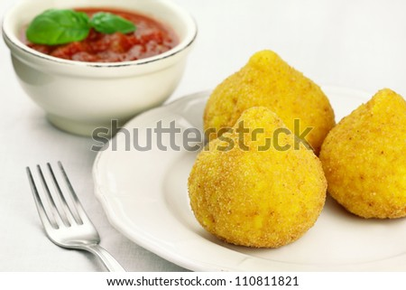 Arancini - deep fried stuffed rice balls typical of Sicily
