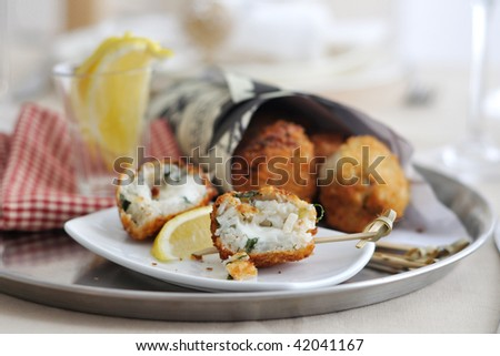Arancini with mozzarella or taleggio and mixed herbs