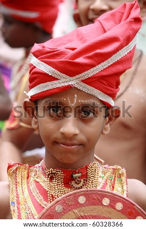 ARANMULA, INDIA - AUGUST 27 : An unidentified child, a Young Velakali performer in costumes during Aranmula Boat Race August 27, 2010 in Aranmula, India. Velakali is a ritual art from Kerala.