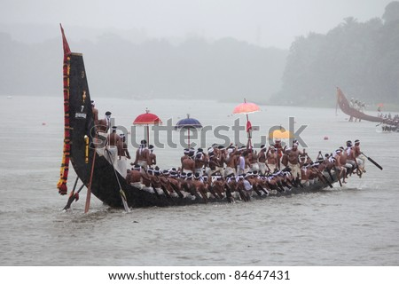 ARANMULA, INDIA - SEPT 14: Oarsmen of a team wearing traditional dress participate at the Aranmula Boat race on September 14, 2011 in Aranmula, Kerala, India.