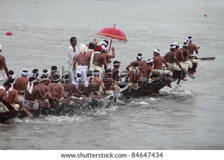 ARANMULA, INDIA - SEPT 14 : Oarsmen of a team wearing traditional dress participate at the Aranmula Boat race on September 14, 2011 in Aranmula, Kerala, India.
