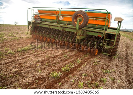 Arapongas / Parana / Brazil - May 03, 2019 - Tractor makes wheat planting in direct plantation system #1389405665