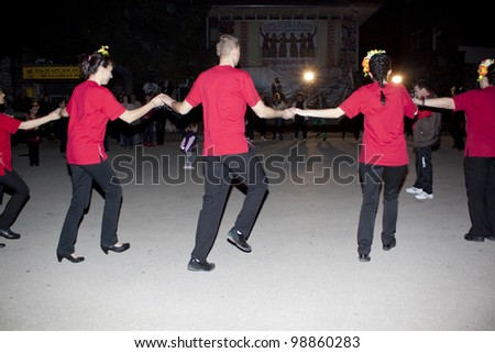 ARBANASSI, BULGARIA - MARCH 24: Veliko Tarnovo\'s dance group perform a traditional ring dance to celebrate \