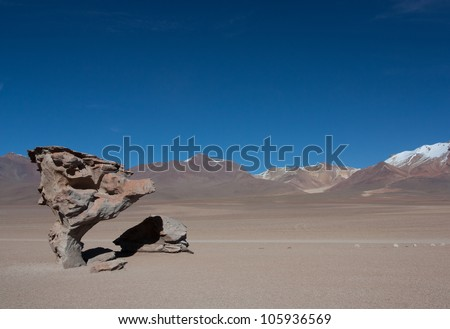 Arbol de Piedra (tree of rock), rock formation created by wind, on the Siloli desert in Eduardo Avaroa Andean Fauna National Reserve in Bolivia. - stock photo