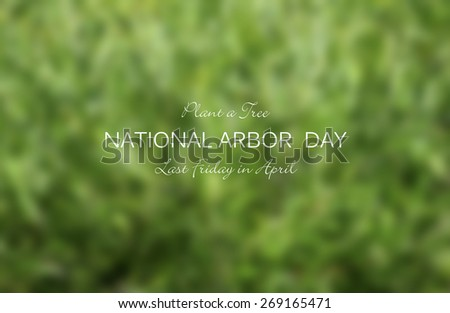 Arbor Day concept with blurred background of lush green leaves with National Arbor Day text and title.