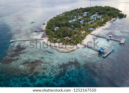 arborek island, one of tourism destination in raja ampat, taken from aerial with drone