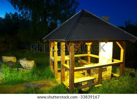 arbour in the summer night at the Altay tourist camp - stock photo