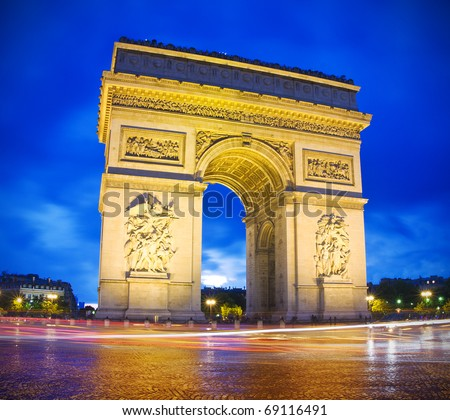 Arc de Triomphe (arch of triumph) in Paris by night