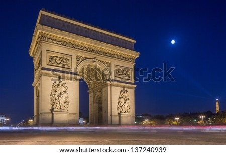 Arc de Triomphe at night in Paris France