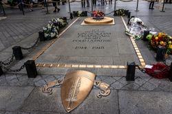 Arc de Triomphe de l'Etoile on Charles de Gaulle Place, Paris, France. Tomb of the Unknown Soldier beneath the Arc. Arc is one of the most famous monuments in Paris.