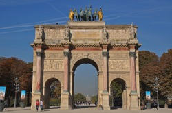 Arc de Triomphe du Carrousel by Louvre Museum with Tuileries Garden in background