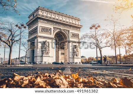 Photo of Arc de Triomphe located in Paris, in autumn scenery.