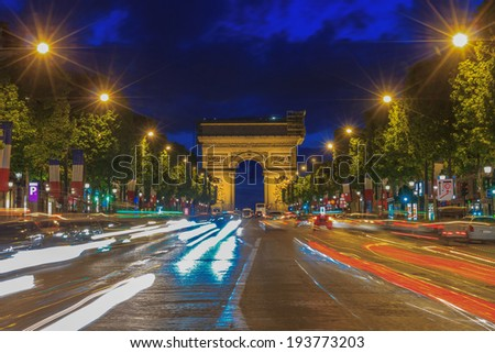 Arc de triomphe Paris (Arch of Triumph and Champs Elysees) at sunset