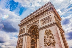 Arc de Triomphe Place Charles de Gaulle Paris France.  Up to Champs Elysees, site of French Unkown soldier. Honors those who fought in Revolutionary Napoleonic and other wars.