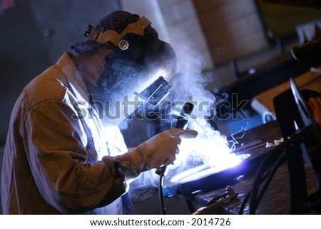 Arc welder at work at his workbench