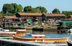 Arcachon Bay, France: the oyster port of La Teste with its traditional fishing boats called Pinasses