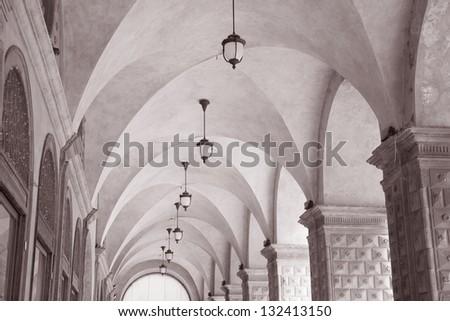 Arcade Arch of Palazzo Podesta on Piazza Maggiore - Main Square, Bolonia, Italy in Black and White Sepia Tone