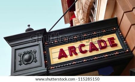 Arcade sign on old movie theater playbill