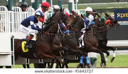 ARCADIA, CA - FEB 19: Jockeys and horses break from the gate for the 1st race at Santa Anita Park in Arcadia, CA, on Feb 19, 2012. Eventual winner is No. 2 Good Gal Friday with Chantal Sutherland up.