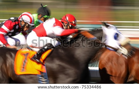 ARCADIA, CA - FEB 10, 2010: Jockeys battle for the lead in a thoroughbred race at historic Santa Anita Park on Feb 10, 2010 in Arcadia, CA.