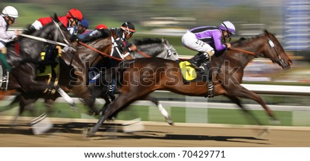 ARCADIA, CA - JAN 29: Jockey Martin Pedroza pilots Champagneandlilies (#6) to victory in a claiming race at Santa Anita Park on Jan 29, 2011 in Arcadia, CA.