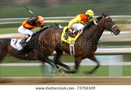 "ARCADIA, CA - MAR 12: Jockey Rafael Bejarano (yellow cap) races ""Kevlar Kid"" to a second-place finish in an allowance race at Santa Anita Park on Mar 12, 2011 in Arcadia, CA."