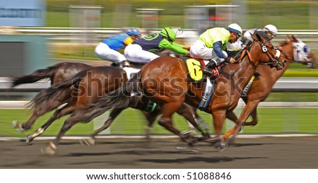 ARCADIA, CA - MAR 24: Jockeys compete in a thoroughbred maiden claiming race at Santa Anita Park on Mar 24, 2010 in Arcadia, CA.