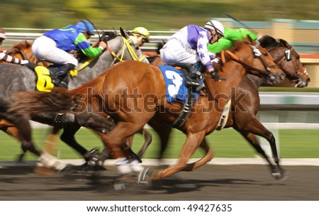 ARCADIA, CA - MAR 4: Jockeys pilot their mounts down the homestretch in an allowance race at Santa Anita Park on Mar 4, 2010, in Arcadia, CA.