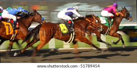 ARCADIA, CA - MAR 4: Jockeys power their mounts down the homestretch in a thoroughbred allowance race at Santa Anita Park on Mar 4, 2010 in Arcadia, CA.