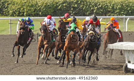 ARCADIA, CA - MAR 20: Thoroughbreds take the turn and start down the homestretch in a maiden race at Santa Anita Park on Mar 20, 2010, in Arcadia, CA.