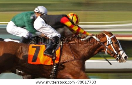 "ARCADIA, CA - MARCH 15: Christian Santiago Reyes and ""Siempre Esperanza"" surge ahead to place 2nd in a maiden race at Santa Anita Park on March 15, 2012 in Arcadia, CA."