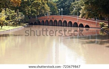 arch brick bridge over the lake ...