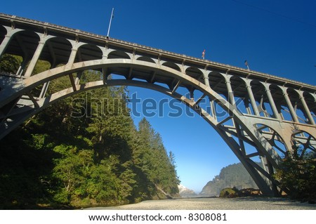 arch bridge over cape creek at pacific coast highway and heceta head lighthouse, oregon