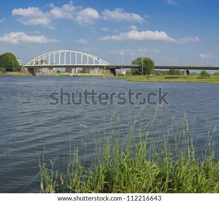 arch bridge over the IJssel river in the Netherlands