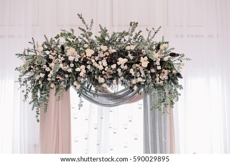 Tag wedding arch avopix arch for the wedding ceremony arch decorated with peachy and silvery cloth and flowers junglespirit Choice Image