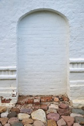 Arch in stone old white wall, Rostov Kremlin, Rostov, one of oldest town and tourist center of Golden Ring, Yaroslavl region, Russia