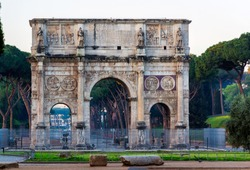 Arch of Constantine and coliseum in background at Rome, Italy