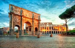 Arch of Constantine and Colosseum in Rome, Italy. Triumphal arch in Rome, Italy. North side, from the Colosseum. . Colosseum is one of the main attractions of Rome. Rome architecture and landmark.