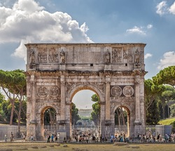 Arch of Constantine - Arch is located in Rome between the Colosseum and the Palatine. It was built in the year 315 and is dedicated to the victory of Constantine over Maxentius.  Rome. Italy.