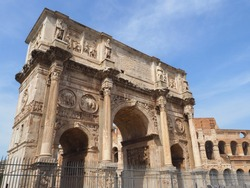 Arch of Constantine or Arco di Costantino and part of Colosseum to right. High Roman structure, triumphal arch, victory over Maxentius at Battle of Milvian Bridge, made up of three decorated arches.