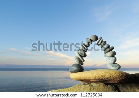 Arch of pebbles in balancing on the seacoast