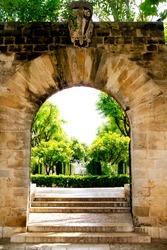 Arch of stone in entrance to Hort del Rei gardens Palma de Mallorca near Almudaina