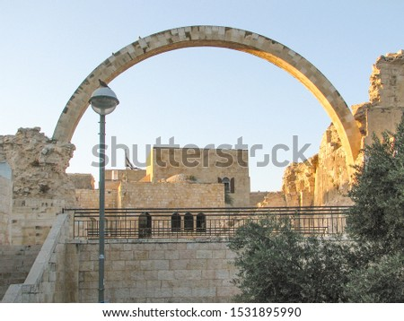 Photo of  Arch of the Hurva Synagogue, also known as The Ruin Synagogue, in Old Walled City of Jerusalem, Israel.  The arch was built in 1977, years after the synagogue was destroyed.  Image has copy space.