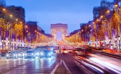 Arch of Triumph and Champs Elysees in Paris at night, France