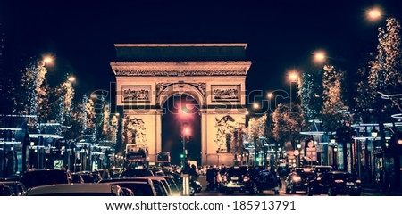 Arch of Triumph and Champs Elysees with Christmas festive illumination. Paris in winter. Toned image.