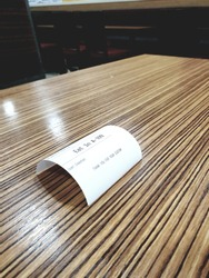 arch receipt on lined wooden table.
