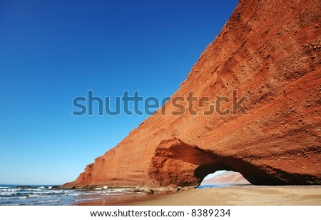 Arch rock formation on the beach. Morocco.
