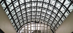 arch shaped glass roof and its frame