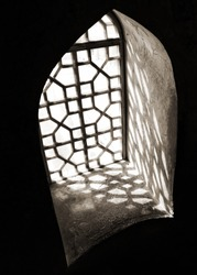 Arch with nice shadows in sepia tonality photo, persian architecture, abstract architectural photo of window and contrast shadow on a floor. Architectural details. Iran, Persia
